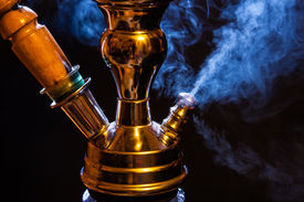 foto of hookah  - Water pipe or hookah with blue smoke