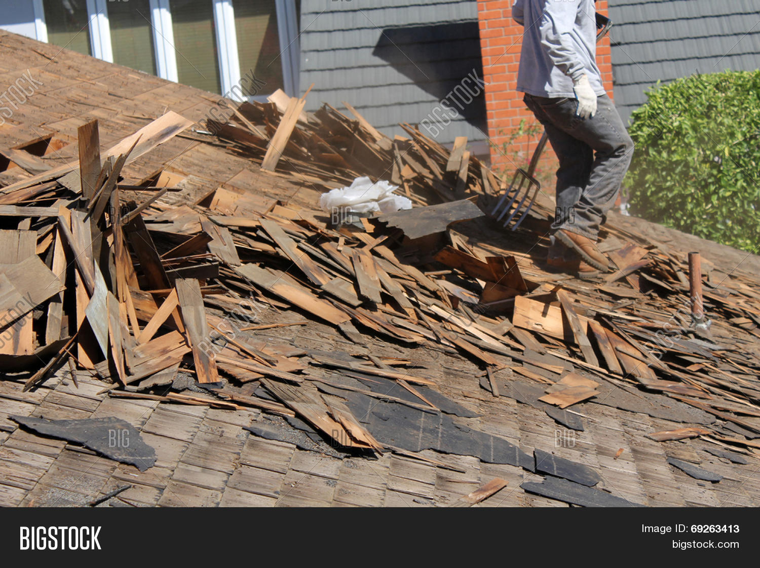 Demolition And Removal Of An Old Asphalt Single Roof That Was Installed  Over An Old Cedar