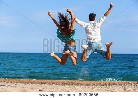 Teen Couple Jumping Giving Backs