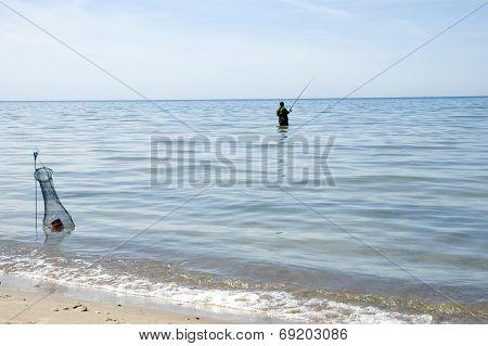 Latvia. The Fisherman At The Coast Of  Baltic Sea