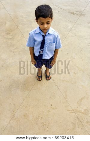 Indian Schoolboy At The Beach With Closed Eyes