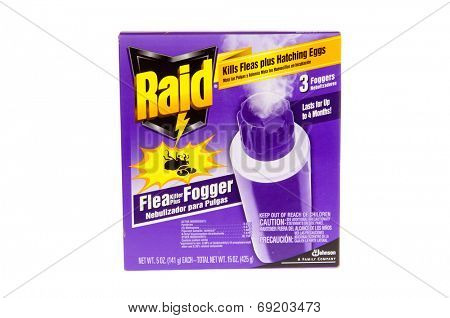 Hayward, CA - July 27, 2014: packet of three 5 oz cans of Raid brand flea killer plus Fogger