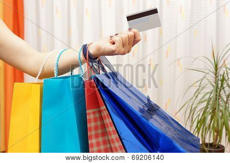 Woman With  Shopping Bags Bought With A Debit Or Credit Card At Home. Shopping From Home Concept