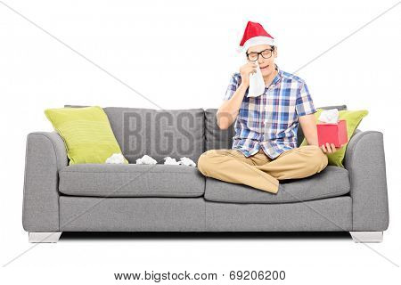 Sad man with Santa hat wiping his eyes from crying isolated on white background