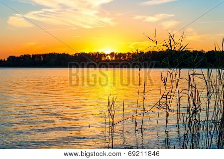 Beautiful Sunset. The Sun Sets Over The Lake