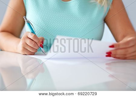 Young Woman Signs A Contract