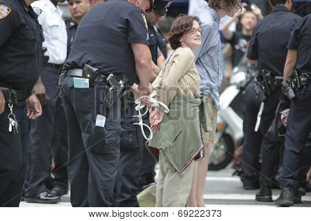Female activist led away in plastic cuffs
