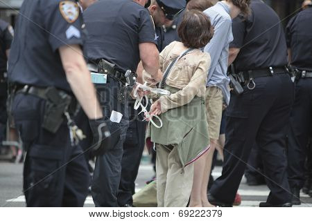 NYPD applying plastic cuffs to activist