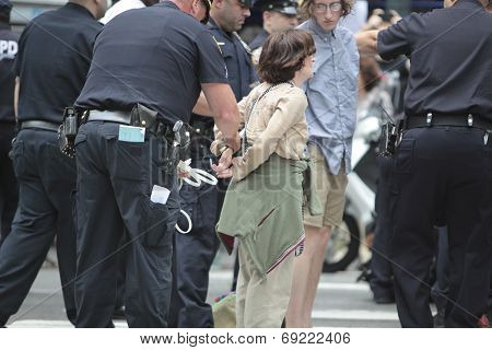 Female activist in cuffs led away