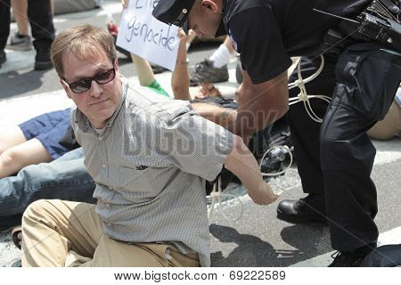 Activist being handcuffed on 2nd Ave