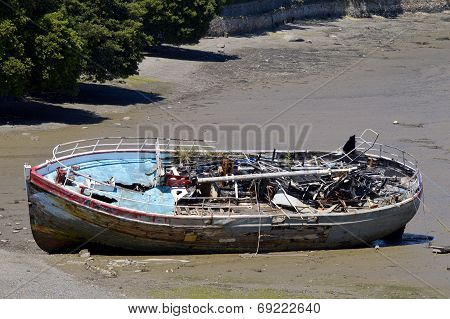 Shipwrecked boat on a beach