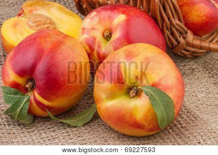 peach or nectarine on burlap background