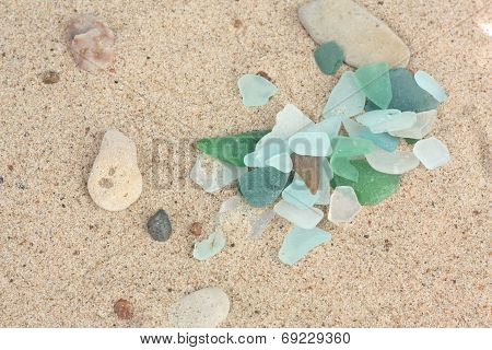 Sand Background With Pieces Of Glass