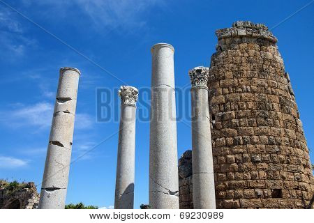 Doric  Columns And The Hellenistic Gate  In The Ancient Greek City Of  Perge,  Turkey.