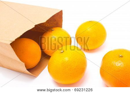 Oranges Falling From Paper Bag