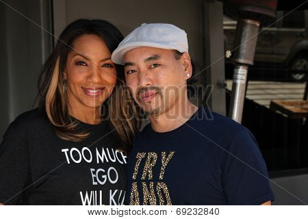 LOS ANGELES - JUL 29:  Arthel Neville, Taku Hirano at the Celebrity Sighting at the Magnolia Restaurant on July 29, 2014 in Los Angeles, CA