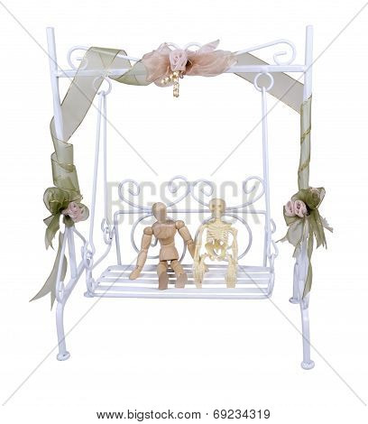 Person And Skeleton On A Garden Swing Set