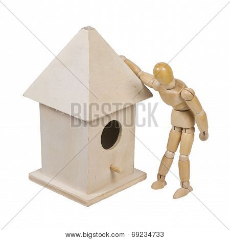 Peering Into A Birdhouse With Roof And A Peg For A Porch