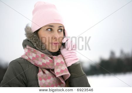 Winter girl on the phone