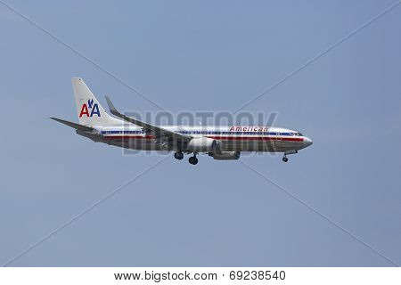 American Airlines Boeing 737 in New York sky before landing at JFK Airport