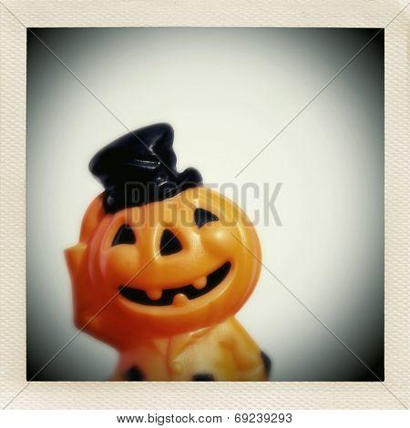 Instagram filtered image of a smiling mid century plastic jack o lantern