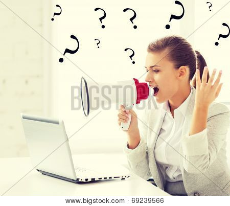 picture of strict businesswoman shouting in megaphone