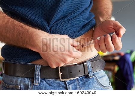 Male Diabetic Injecting Themselves With Insulin