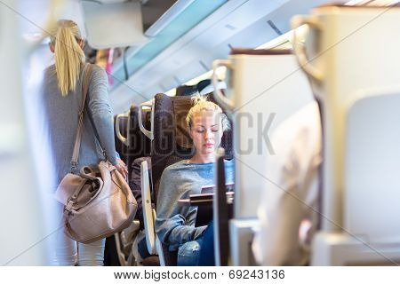 Lady traveling by train.