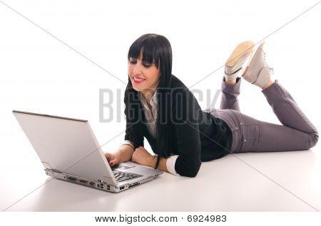 Beautiful young girl lying on the floor