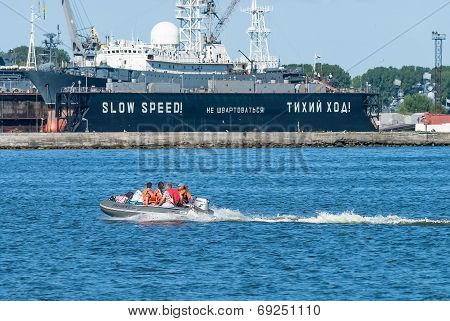 People in rubber boat with motor float
