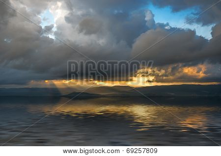Storm Clouds And Rays Of The Sun Through The Clouds