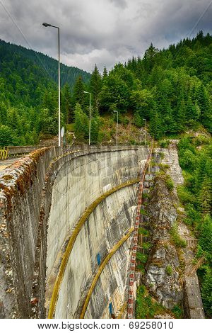 Small hydro electric dam harnessing water power in a mountain area