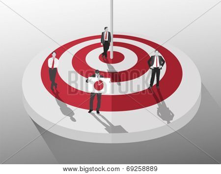 Businessmen standing around red and white target