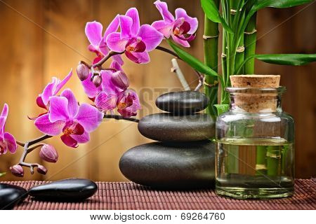 spa concept with zen basalt stones and orchid on the wood