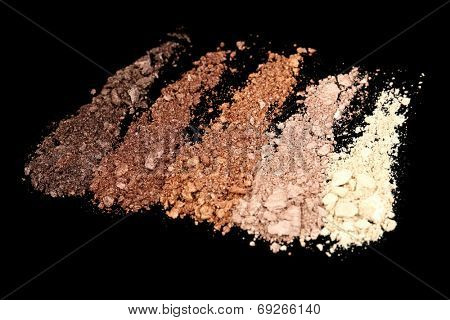 Crushed eyeshadow isolated on black