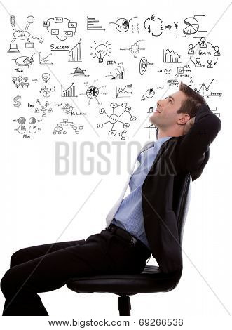 Young business man looking up and planning with business graph