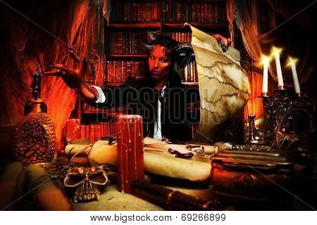 Horned Devil in his home. Fantasy. Ancient style. Halloween.