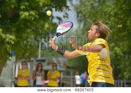 MOSCOW, RUSSIA - JULY 18, 2014: Vinicius Font of Brazil in the match against Cyprus during ITF Beach Tennis World Team Championship. Brazil won 3-0