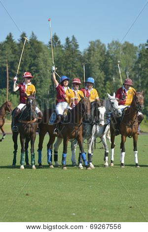 TSELEEVO, MOSCOW REGION, RUSSIA - JULY 26, 2014: Team of Tseleevo polo club before the match against Oxbridge polo team during the British Polo Day. Oxbridge won 5-4