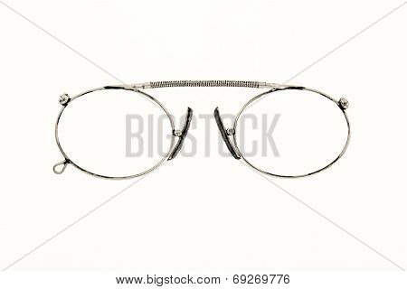 Old Chromeplated Eyeglasses On A White Background