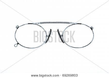Silver Eyeglasses Closeup On A White Background