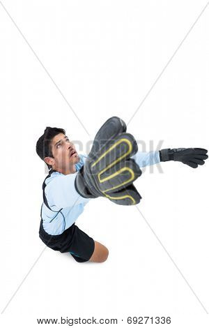 Goalkeeper in blue making a save on white background