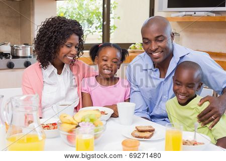 Happy family having breakfast together in the morning at home in the kitchen