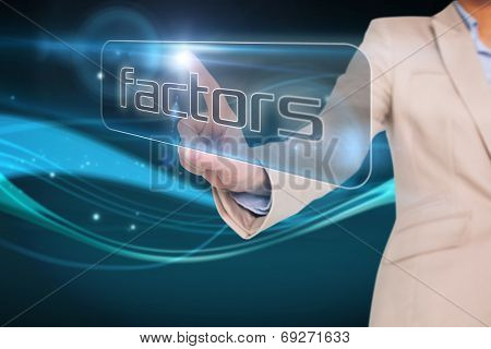 Businesswoman pointing to word factors against abstract glowing black background