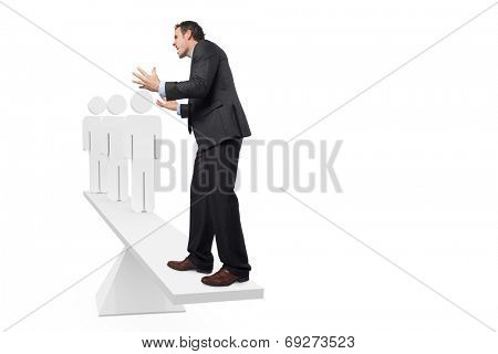 Scales weighing stressed businessman and stick men against white scales with human figures