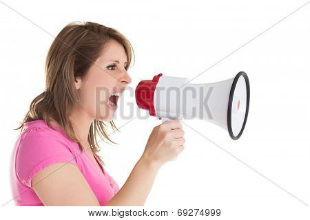 Close up side view of woman shouting into bullhorn over white background