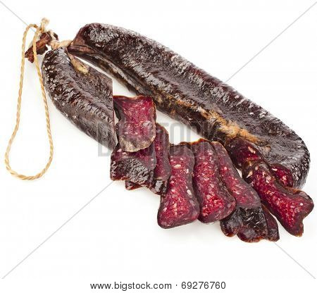 Turkic solid sausages sudzhuk isolated on white background