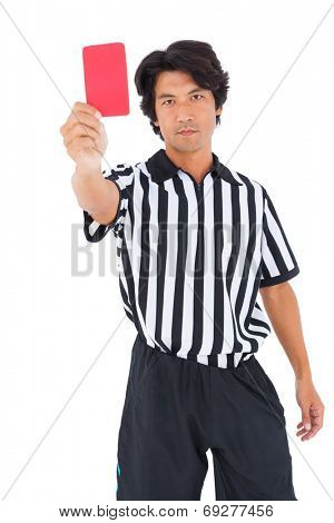 Stern referee showing red card on white background