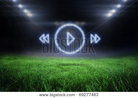 Cloud in shape of music player menu against football pitch with bright lights