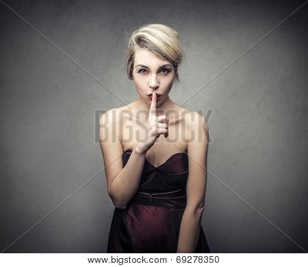 elegant woman shushes someone
